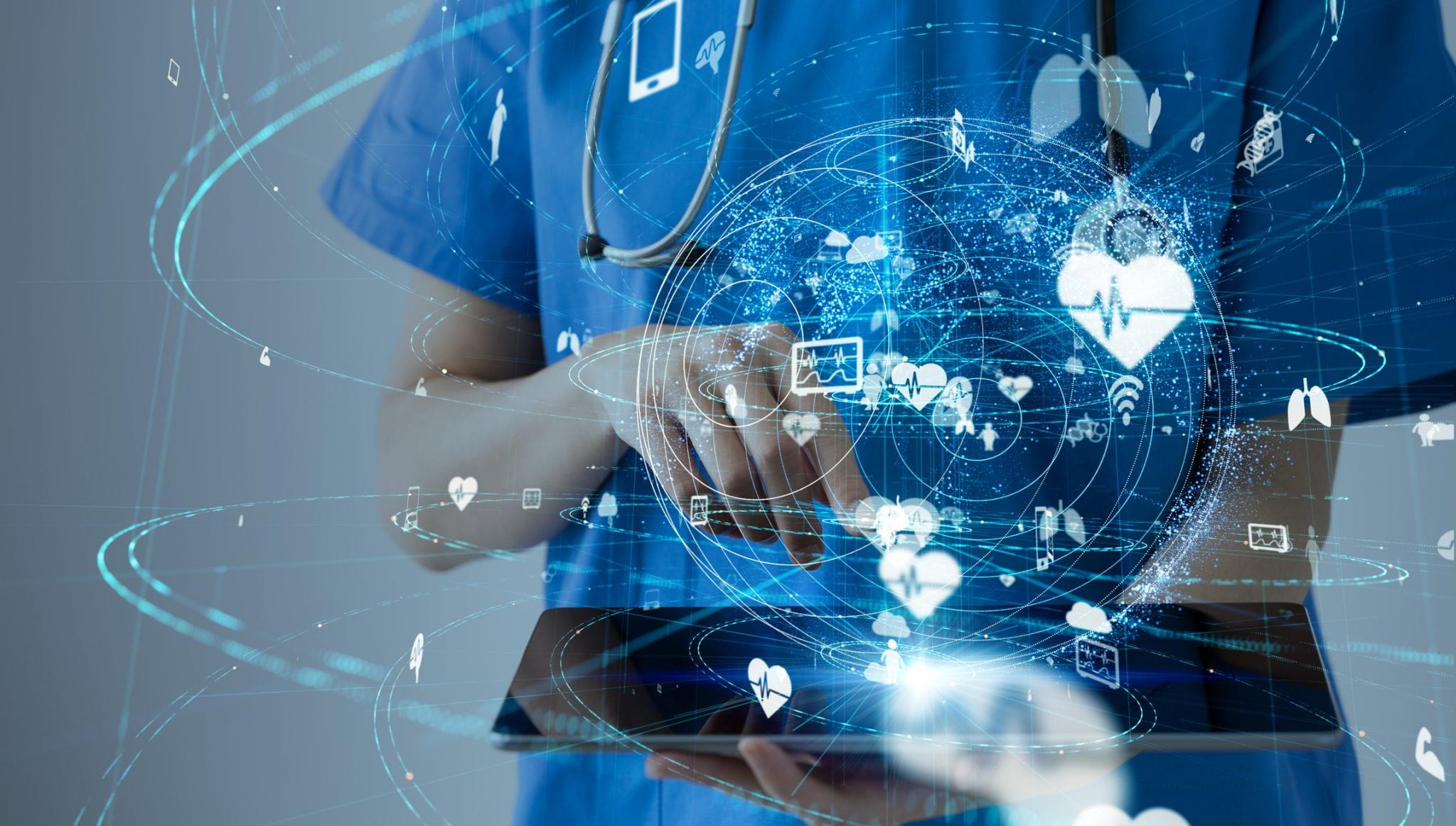 medical professional using ipad