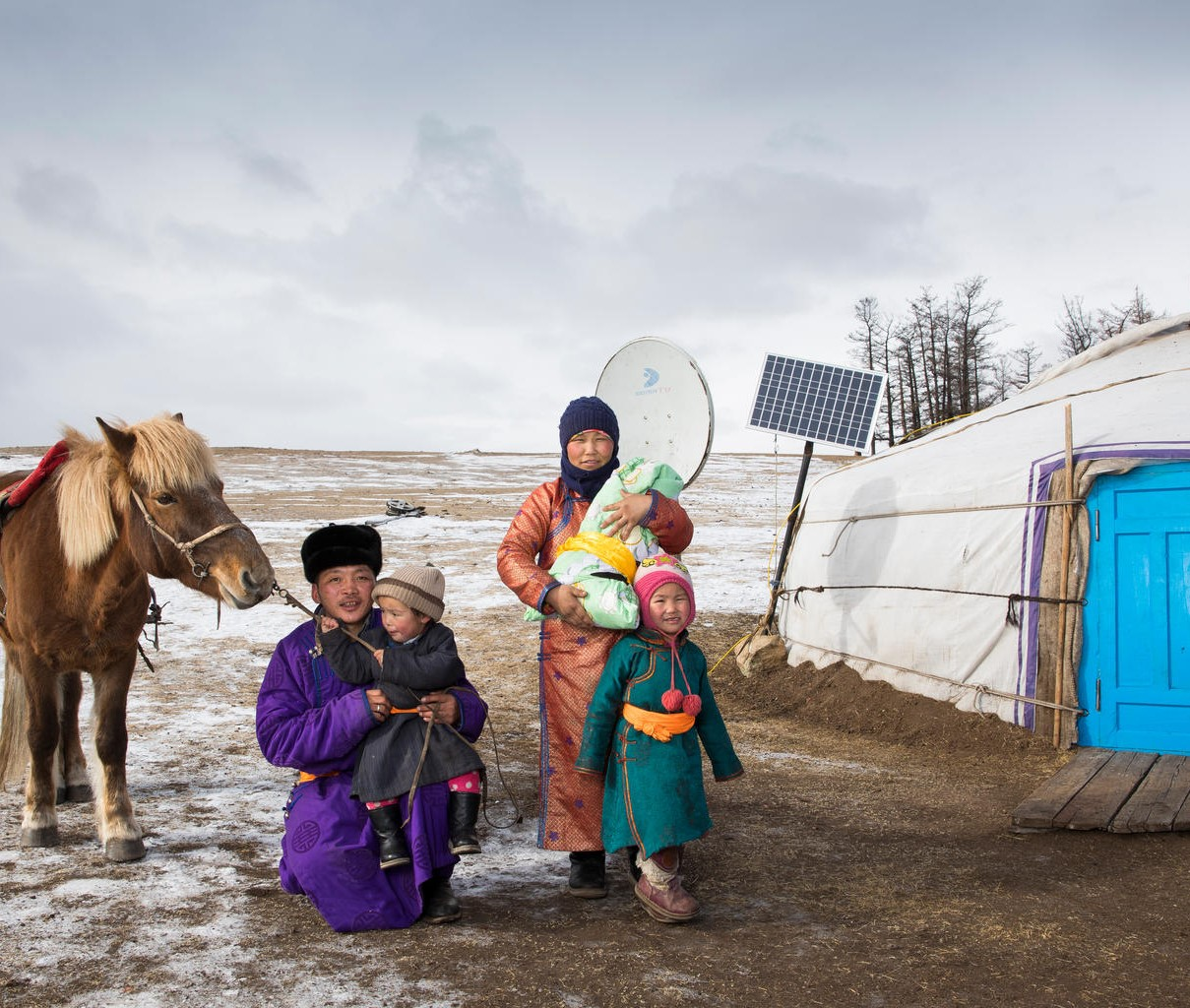 Mother Delgermurun holds newborn Sugarmaa, outside their home in the northernmost area of Mongolia ©UNICEF