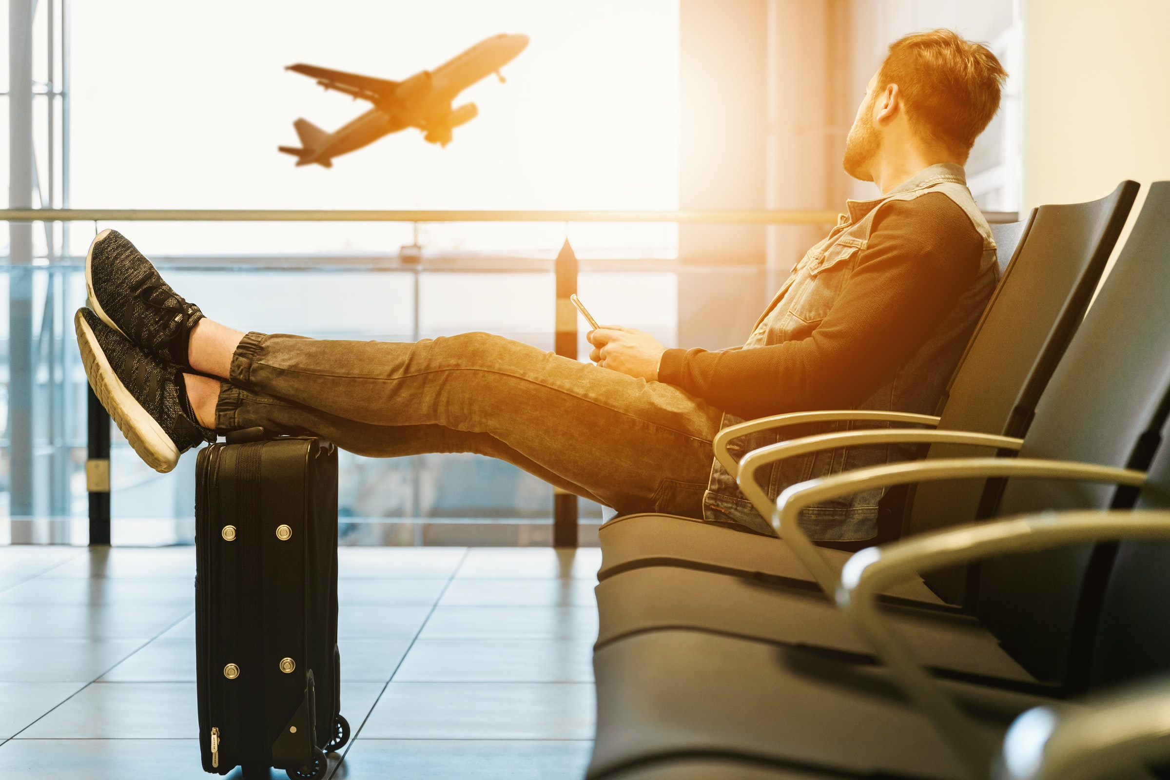 man in airport looking at aeroplane